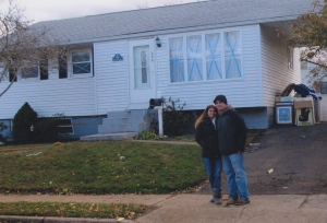 Melissa and Chris Heugle in front of their Union Beach home just before it was demolished.